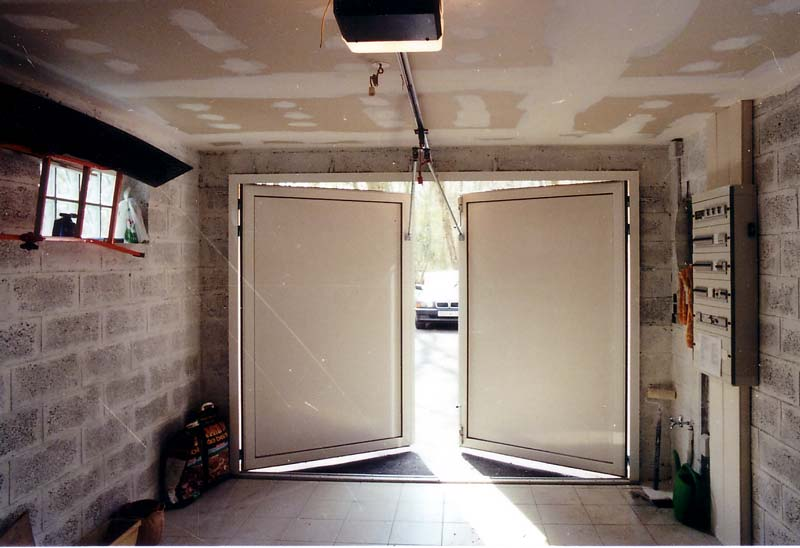 Isolation porte de garage battant bois perfect for Porte de garage pvc imitation bois